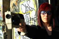 Woman aiming sci-fi gun Stock Image