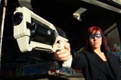Woman aiming sci-fi gun Royalty Free Stock Photos