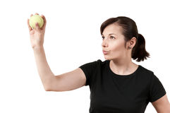 Woman aiming with a tennis ball. Over a white background Stock Photo