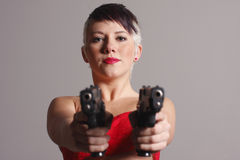 Woman aiming two pistols Royalty Free Stock Image