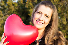 Woman with air balloon like heart Royalty Free Stock Image