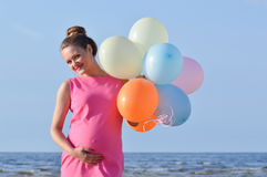 Woman with air balloons Stock Photography