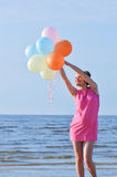 Woman with air balloons Royalty Free Stock Images