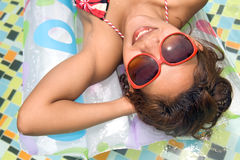 Woman on air bed. Young woman on air bed in the pool Royalty Free Stock Photos