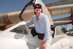Woman and air-plane. Stock Images
