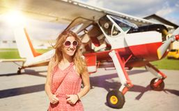 Woman and aircraft Stock Photography