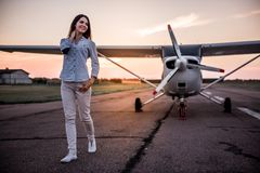 Woman and aircraft royalty free stock image