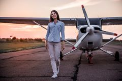 Woman and aircraft stock images