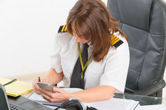 Woman airline pilot at the office Stock Photos