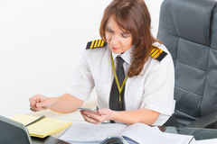 Woman airline pilot at the office Royalty Free Stock Images