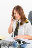 Woman airline pilot at the office Stock Image