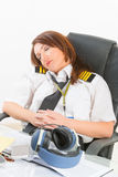 Woman airline pilot sleeping in the office Royalty Free Stock Photo
