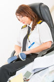 Woman airline pilot sleeping in the office Stock Images