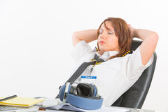 Woman airline pilot sleeping in the office Royalty Free Stock Image