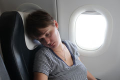 Woman at airplane Stock Image