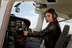 Woman in airplane cockpit. A woman flying an airplane Royalty Free Stock Photos