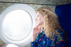 Woman in airplane Royalty Free Stock Photos