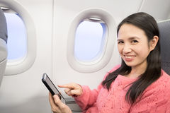 Woman in airplane Royalty Free Stock Photography