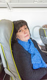 Woman in airplane seat Stock Images