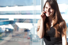 Woman in the airport Royalty Free Stock Photography