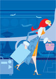 Woman at the airport. A red haired woman is walking at the airport with bags Stock Images