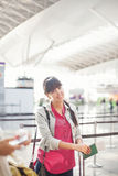 Woman at airport Stock Image