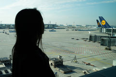 Woman in airport, Frankfurt am Main, Germany Stock Images