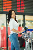Woman airport information board Stock Photography