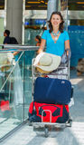Woman at the airport Stock Images