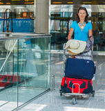 Woman at the airport Stock Photography