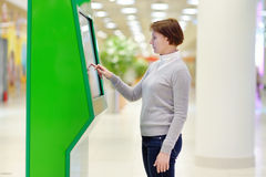 Woman in airport or shopping mall Stock Photos