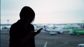 Woman in airport terminal waiting for flight.  stock video