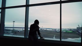 Woman in airport terminal waiting for flight.  stock video footage