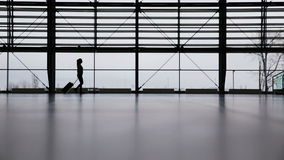 Woman in airport terminal Stock Images
