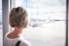 Woman at the airport window Royalty Free Stock Photography