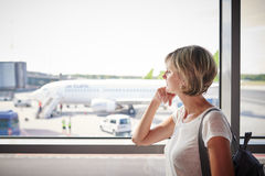 Woman at the airport window Royalty Free Stock Image