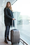 Woman at the airport in winter Stock Photos