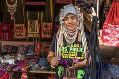 AHKA Hill Tribe Woman, Northern Thailand. Woman from the Akha tribe with traditional headgear sells souvenirs, Chiang Rai, Thailand, Asia royalty free stock image