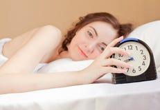 Woman and alarm Stock Image