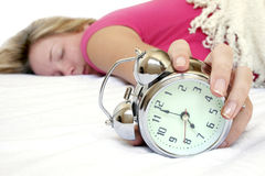 Woman and Alarm Royalty Free Stock Image