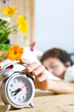 Woman and alarm Stock Photography