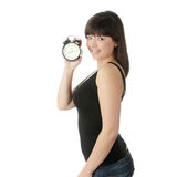 Woman with alarm clock Royalty Free Stock Images