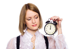 Woman with an alarm clock Stock Image