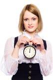 Woman with an alarm clock Stock Photo
