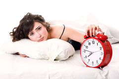 Woman with alarm clock Stock Image