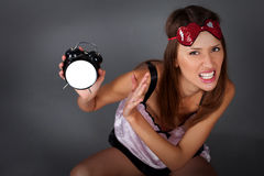 Woman with alarm clock Royalty Free Stock Image
