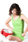 Woman with alarm clock Royalty Free Stock Photos