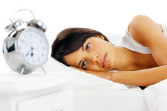 Woman alarm clock Royalty Free Stock Images