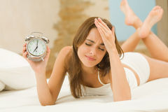 Woman with alarm-clock Royalty Free Stock Photo