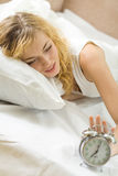 Woman with alarm-clock Stock Photography